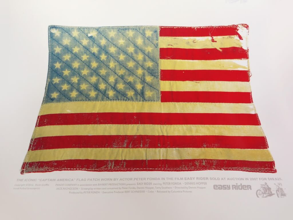 "The iconic ""Captain America"" flag patch worn by actor Peter Fonda in the film Easy Rider sold at auction in 2007 for $89,625. This is a 5 color Hand Pulled Screenprint with Metallic Ink throughout and is printed on White Gold Metallic paper. These will be available at the Officially Limited Presents ""Beauty of the Beast"" , a motorcycle themed art show at Galerie F in Chicago on February 7th. MORE INFO: https://www.facebook.com/events/1507019876189998/"